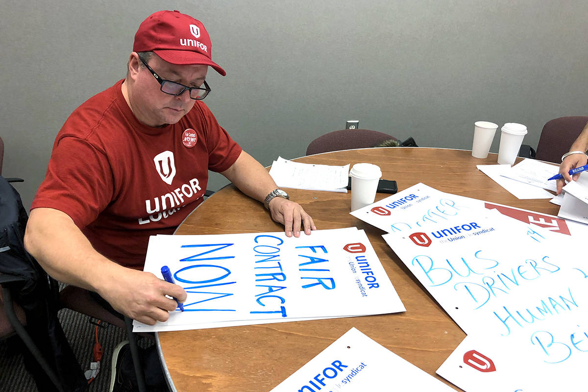 Unifor members prepare picket signs at union headquarters in New Westminster on Wednesday, Nov. 20, 2019. The union has said its workers will put buses and SeaBus behind picket lines starting Wednesday, Nov. 27. (Katya Slepian/Black Press Media)