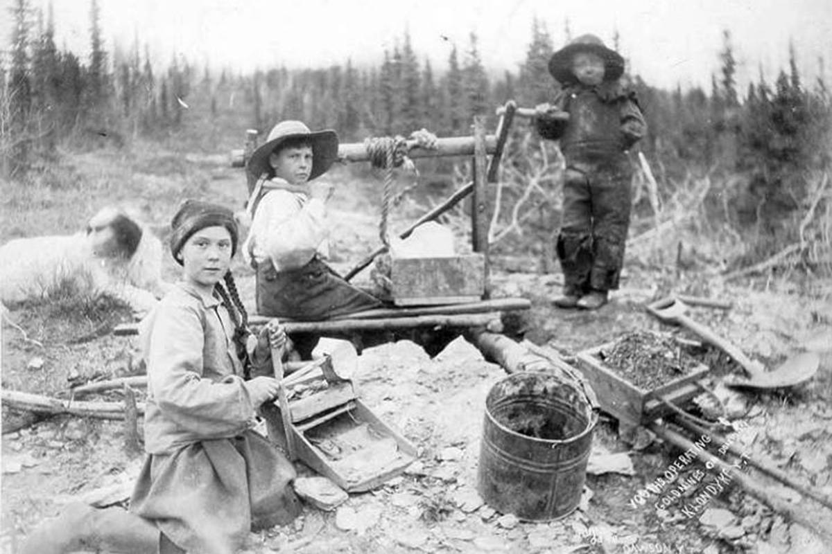 'Three children operating rocker at a gold mine on Dominion Creek, Yukon Territory, ca. 1989' shot by Eric A. Hegg. (University of Washington Archives)