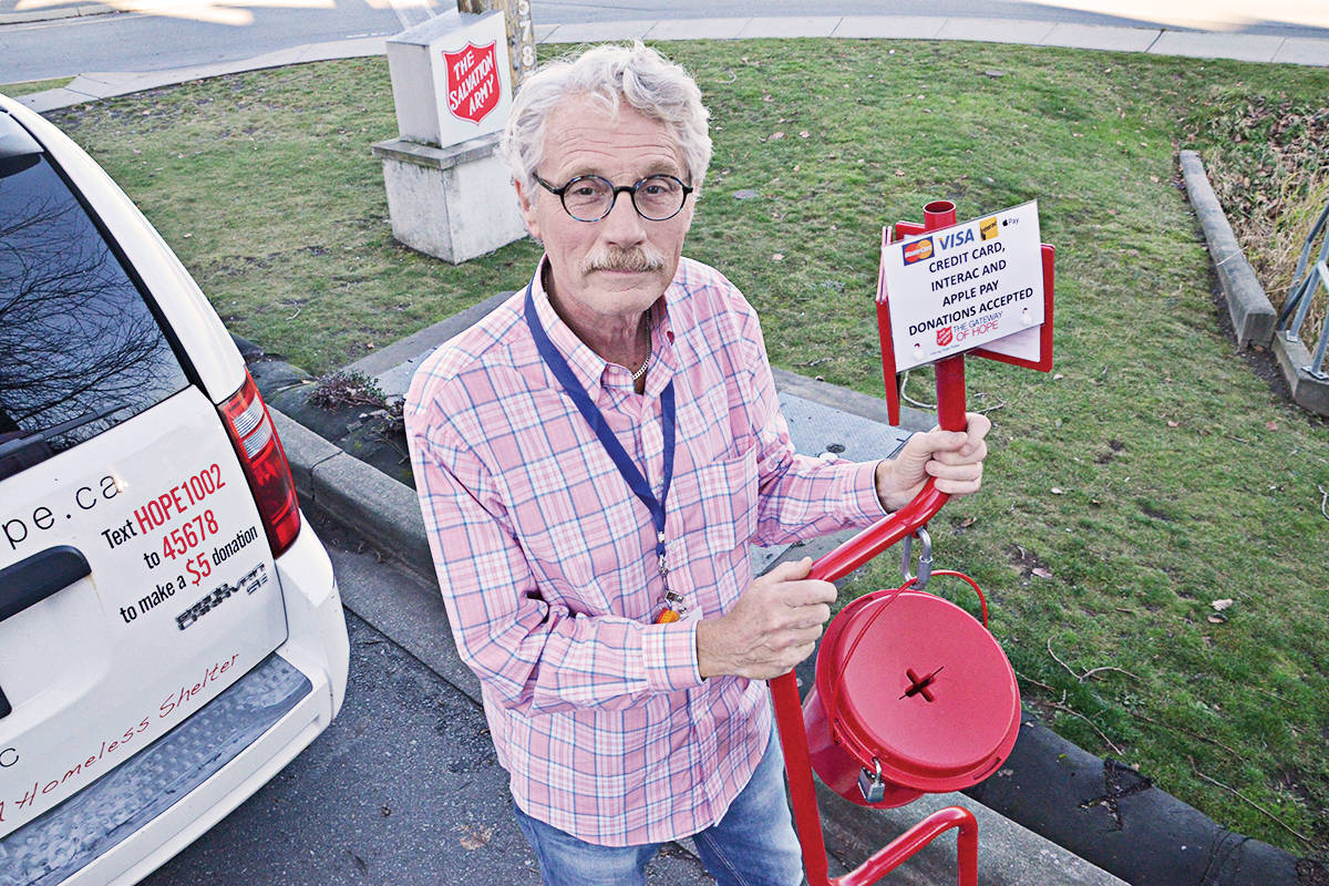 Carl Pauls notes that this year there will be eight debit/credit card readers with kettles for people to make donations around Langley. (Matthew Claxton/Langley Advance Times)