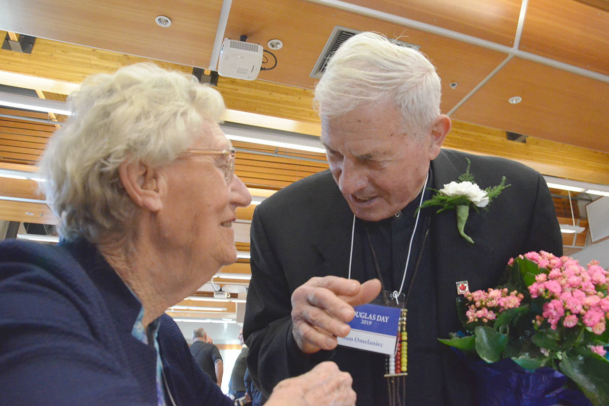 The Pioneer Banquet is a chance for longtime residents to catch up with old friends. Alice Johnson chatted with Sam Omeleniac. (Heather Colpitts/Langley Advance Times)