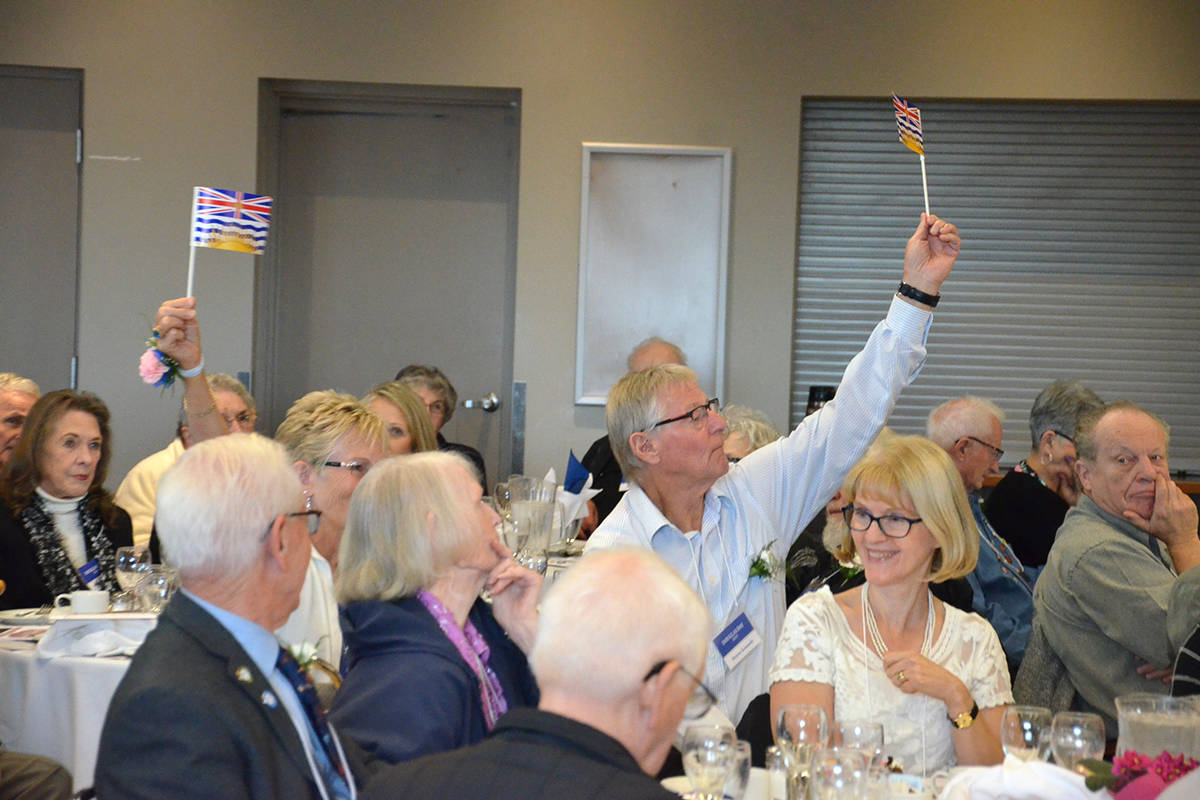 Langley pioneers waved B.C. flags when their names were read off. Langley is home to more than 200 people considered pioneers (be at least 70 years of age and lived here at least 60 years). (Heather Colpitts/Langley Advance Times)