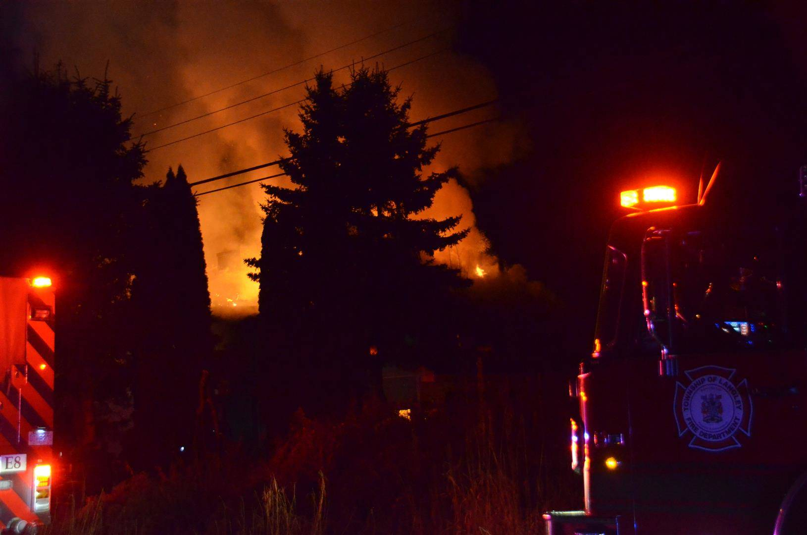 Township fire crews responded to a house fire early Thursday morning where at least one person was taken away on a stretcher. (Curtis Kreklau/South Fraser News Services)