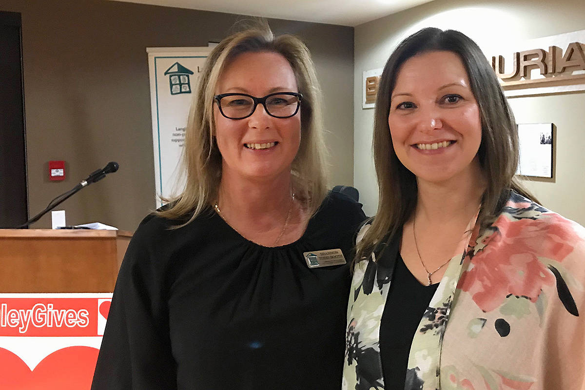 Hospice's Shannon Todd Booth thanked Tanya Gabara of Gateway Casinos & Entertainment for the $25,000 gift she presented on behalf of Langley City's own Cascades Casino. The presentation for the new hospice residence was made during Saturday's second annual Glass Half Full fundraiser. (Lisa Farquharson/Langley Advance Times)