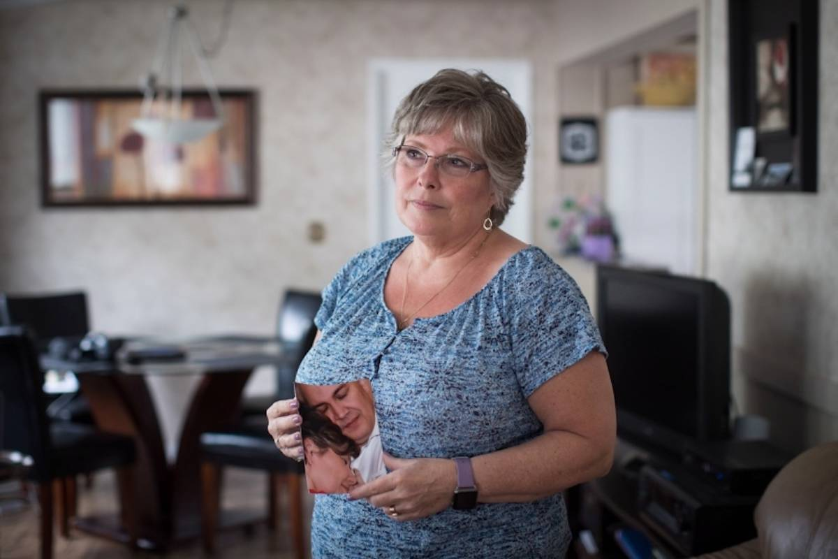 "Aldergrove resident Wendy Gould lost her husband George last year in January after he battled cancer, and a superbug he may have contracted from an endoscopy at Vancouver General Hospital. Gould said her ""life was ripped away from her,"" holding a picture of the two on their wedding day in 2010. (Canadian Press photo)"