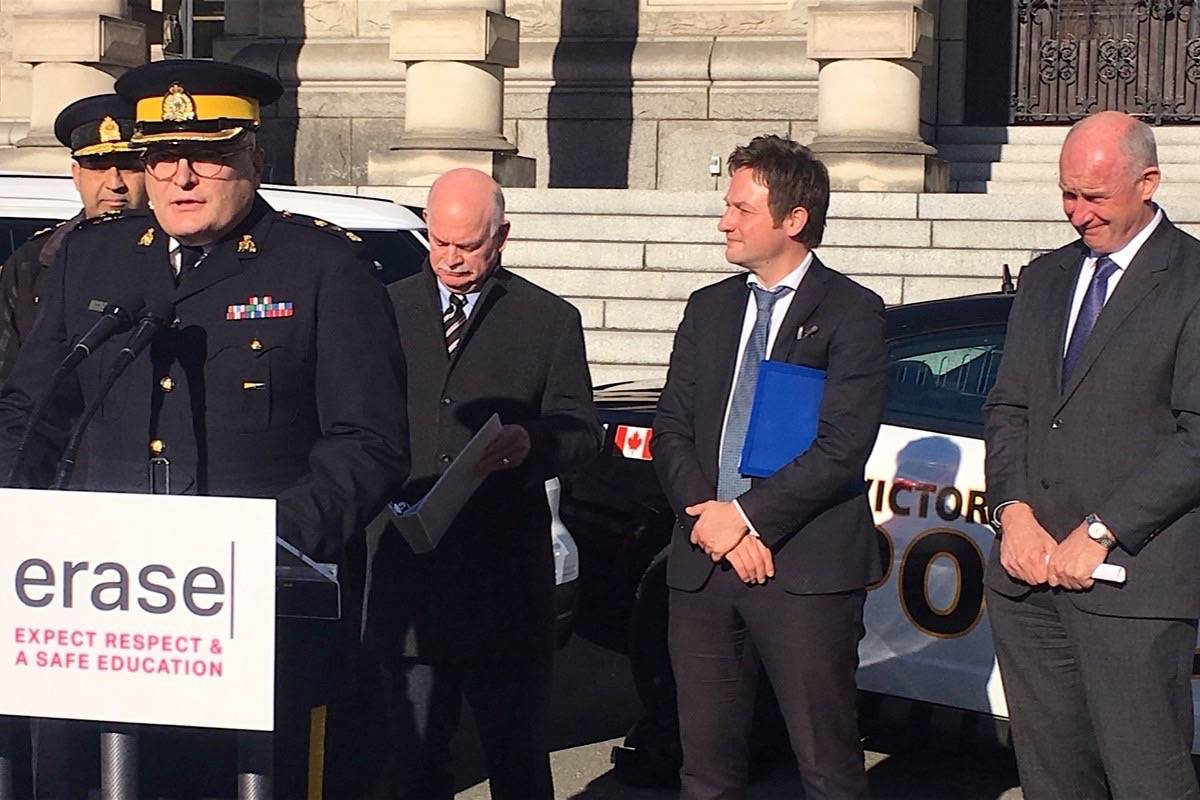 Supt. Ted De Jager of the Penticton RCMP speaks to school anti-violence event at the B.C. legislature, joined by Victoria Police Chief Del Manak (left), Surrey-Guildford MLA Garry Begg, Education Minister Rob Fleming and Public Safety Minister Mike Farnworth, Nov. 21, 2019. (Tom Fletcher/Black Press)
