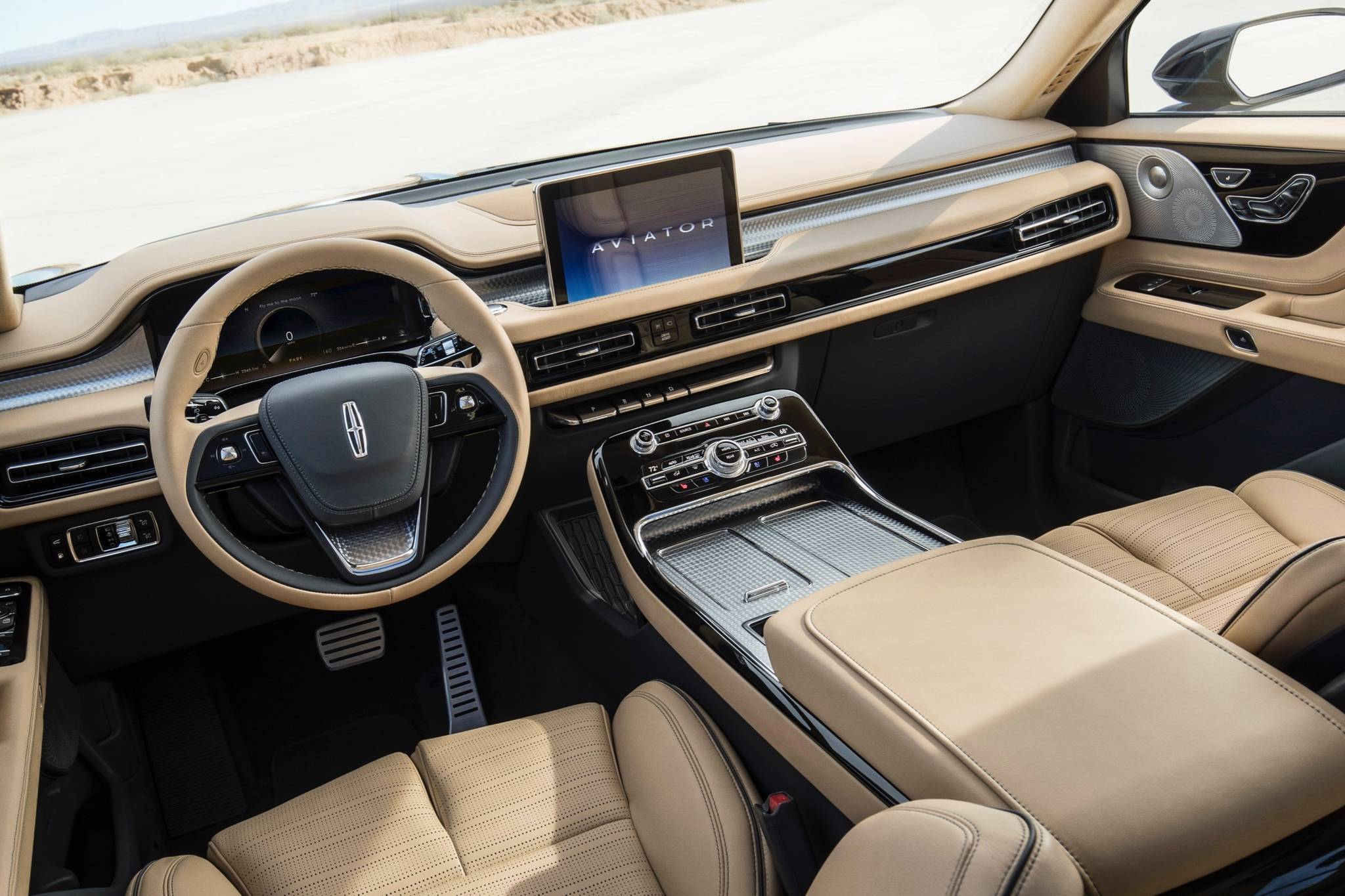 The screen popping out of the dash is the only distraction to an otherwise clean and elegant interior. Note the transmission is operated via a row of dash-mounted buttons. Photo: Lincoln