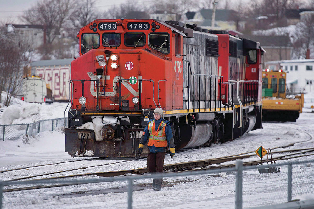 A CN locomotive moves in the railway yard in Dartmouth, N.S. on Monday, Feb. 23, 2015. Unifor said it has reached a late night deal with Canadian National Railway to avoid a lockout of 4,800 workers.THE CANADIAN PRESS/Andrew Vaughan
