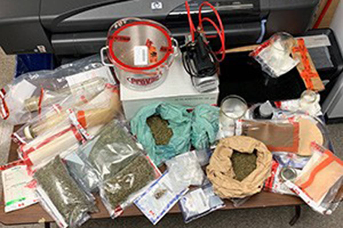 Items seized by the Canadian Forces National Investigation Service on July 12, 2019, in connection to charges laid against Master Cpl. Joshua Alexander. Pictured: 1450 grams of vegetative cannabis; three cans of compressed butane; a propane canister; vacuum chamber attached to a vacuum pump; one baking dish; 2 grams of Psylocybin (Magic Mushrooms); and cannabis solid concentrate. (CFNIS handout)