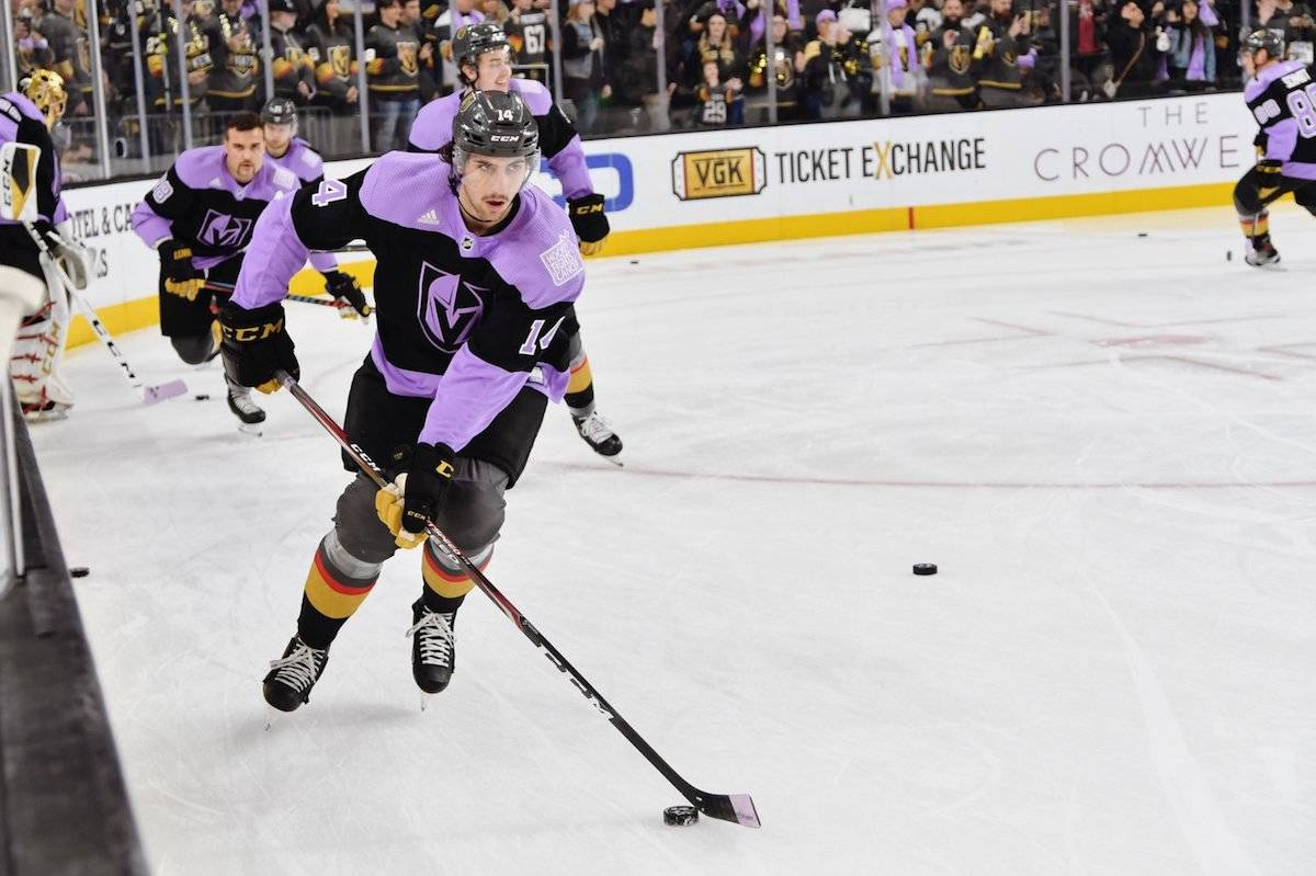 During pre-game warm-up Las Vegas players donned purple jerseys that were auctioned off with proceeds going towards early cancer detection. (Golden Knights photo)