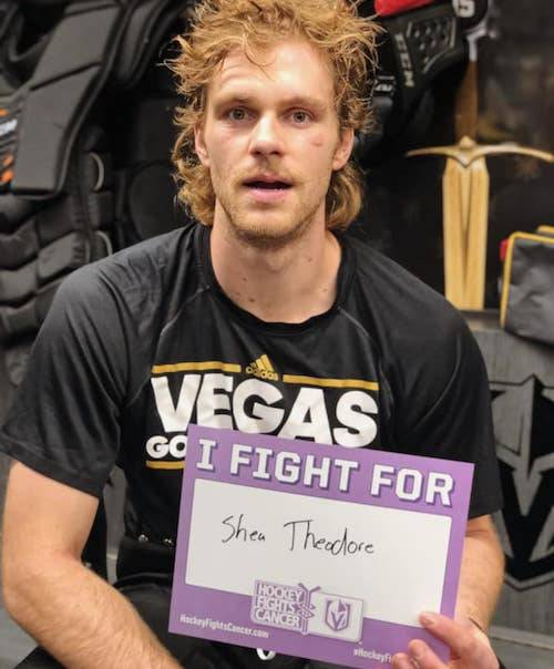 "Las Vegas defenceman Jon Merrill held up an ""I fight for"" purple sign that read Theodore's name. (Golden Knights photo)"