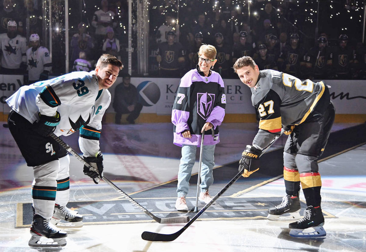 Theodore escorted Darlington out onto center ice in a purple jersey. She dropped the puck amidst a sea of cell phone lights and a roar of arena applause. (Golden Knights photo)