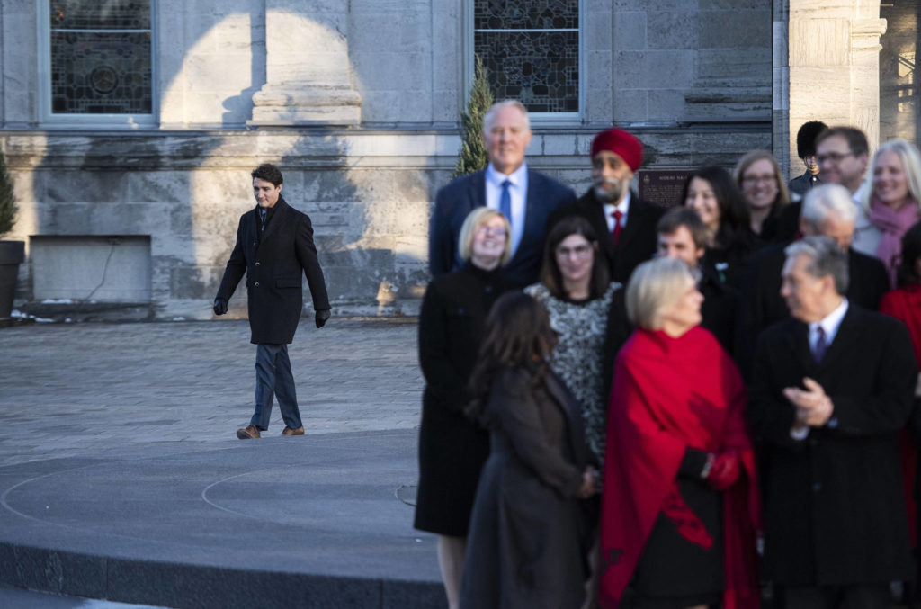 Prime Minister Justin Trudeau walks towards his cabinet to speak to reporters following a swearing in ceremony at Rideau Hall in Ottawa, on Wednesday, Nov. 20, 2019. THE CANADIAN PRESS/Justin Tang