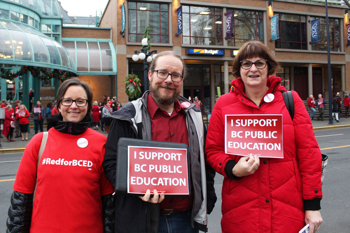 Coquitlam teachers Tessa Voykin (left) and Diether Malakoff (middle) and Lake Cowichan Teachers' Association President Chriss Rolls (right) came to Victoria to protest with about 300 other BCTF members on Saturday. (Devon Bidal/News Staff)