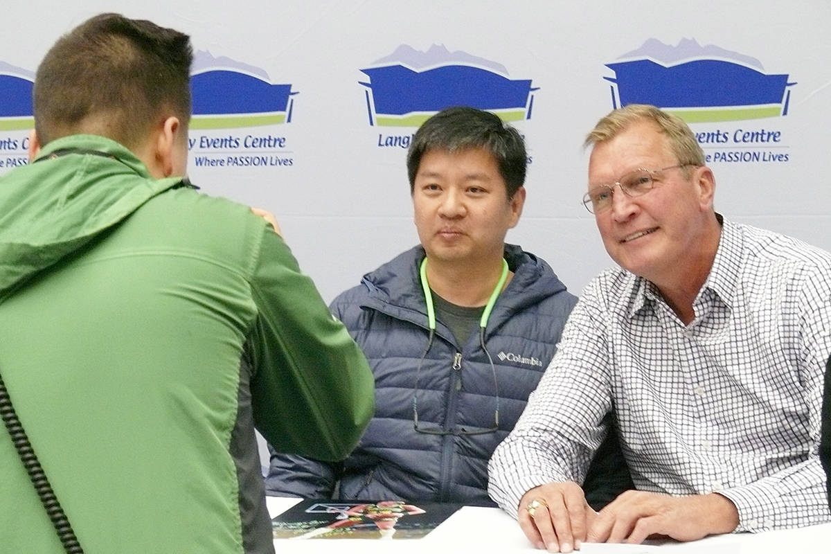 A fan had his picture taken with NBA star Jack Sikma at the annual Western Canada Collectibles Experience (WCCE) show at the Langley Events Centre. (Dan Ferguson/Langley Advance Times)