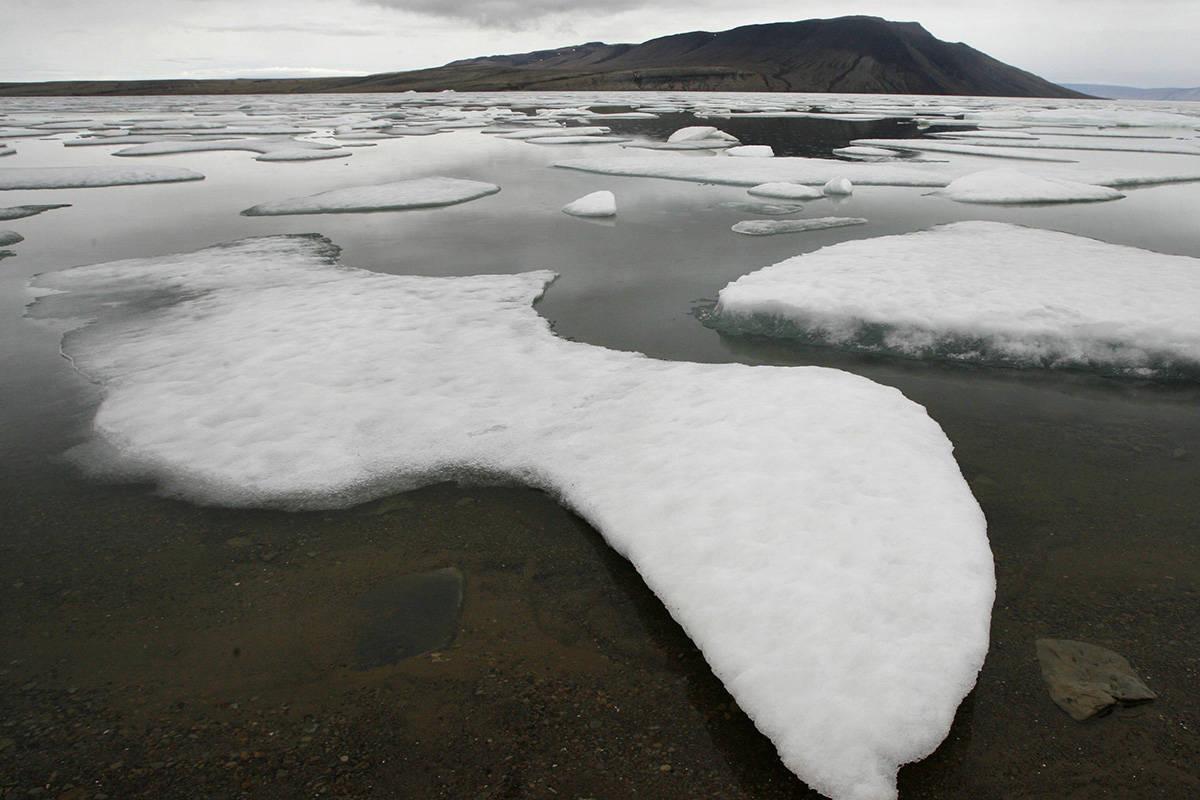 Ice floats in Slidre Fjord outside the Eureka Weather Station, on Ellesmere Island, Nunavut, Monday, July 24, 2006. THE CANADIAN PRESS/Jeff McIntosh