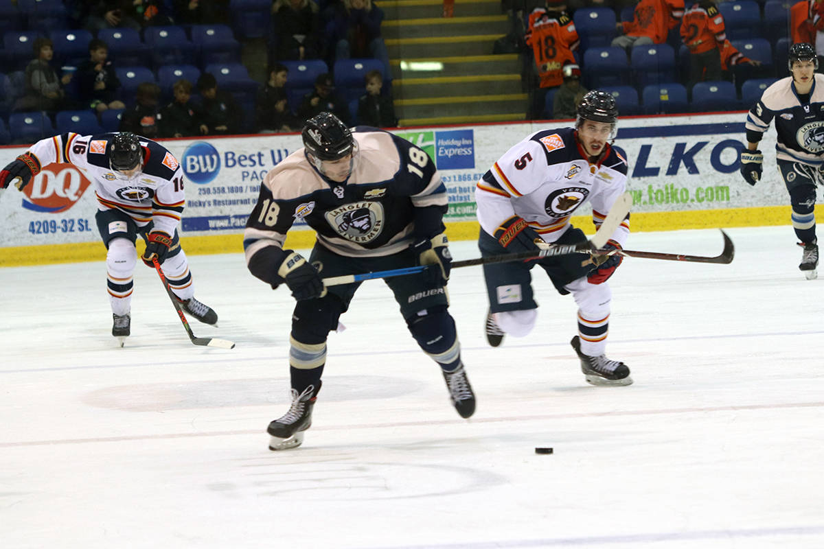 Langley Rivermen forward Sean Bunting speeds away Vernon defenders Dawson Holt (16) and Jackson Caller during the Rivermen's 3-1 B.C. Hockey League win Saturday, Nov. 23, in Vernon. (Roger Knox - Black Press)