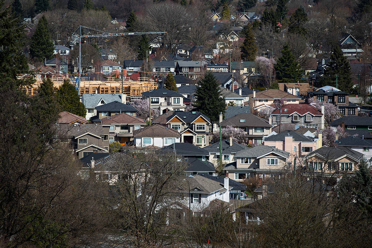 A condo building is seen under construction surrounded by houses in Vancouver, B.C., on Friday March 30, 2018. Housing sales in British Columbia are climbing faster than anticipated after a downturn, but a rebound won't be as inflamed as the sellers' market two years ago, says a report released Monday by Central 1 Credit Union. THE CANADIAN PRESS/Darryl Dyck