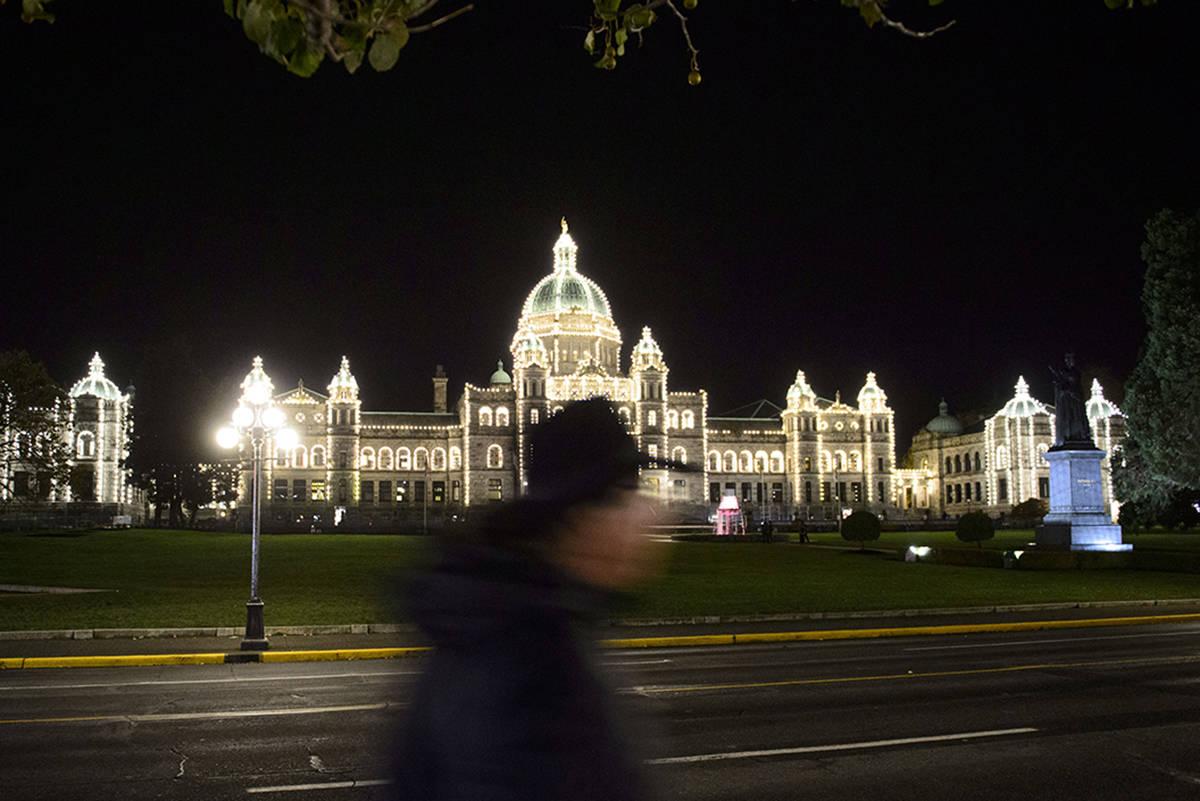 A person walks past the British Columbia legislature in Victoria on Sunday, Oct. 20, 2019. THE CANADIAN PRESS/Sean Kilpatrick