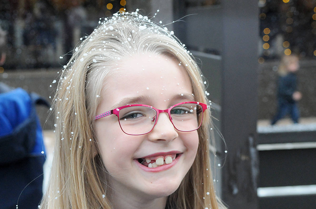 Jordyn Elliott, 8, from Aldergrove got a dusting of artificial snow courtesy of a roof-mounted machine during the Christmas Wish Breakfast held at Newlands Golf & Country early Tuesday morning (Nov. 26) in Langley. (Dan Ferguson/Langley Advance Times)