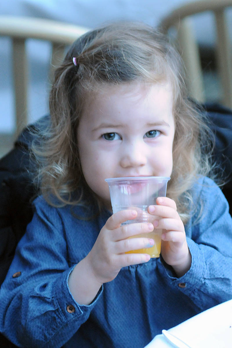 Sophie Currie, three, from Murrayville, had orange juice at the Christmas Wish Breakfast held at Newlands Golf & Country early Tuesday morning (Nov. 26) in Langley. (Dan Ferguson/Langley Advance Times)