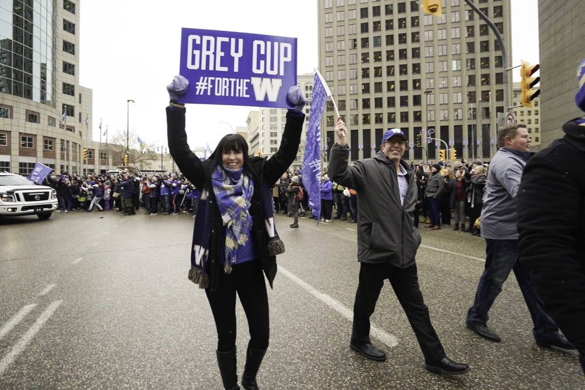 Chair of Winnipeg Blue Bombers board of directors Dayna Spiring joins Winnipeggers on downtown streets Tuesday, Nov. 26, 2019, to celebrate the end of a Grey Cup drought that lasted almost three decades. (THE CANADIAN PRESS/HO-Economic Development Winnipeg, Tyler Walsh)