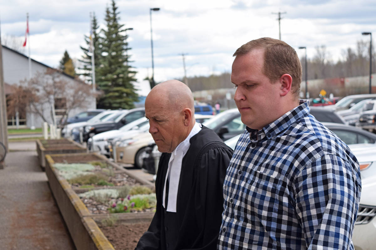 Luke Strimbold, right, enters the Smithers courthouse May 6 with his lawyer Stan Tessmer, to plead guilty to four sexual assault charges. (Trevor Hewitt photo)