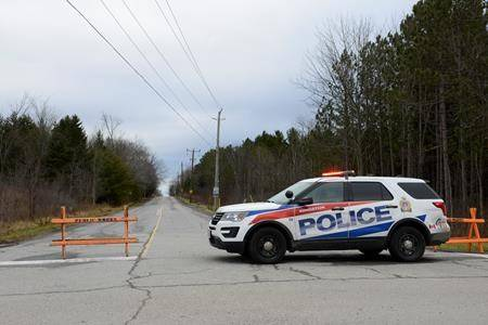 A police car blocks the end of Creekford Road in Kingston, Ont., on Thursday, Nov. 28, 2019. THE CANADIAN PRESS/Sean Kilpatrick
