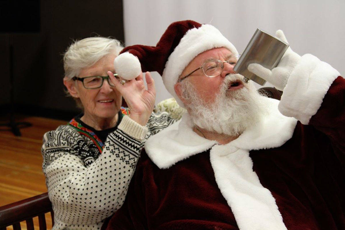 Gary Haupt (right) lost his upcoming job as Penticton's Cherry Lane Shopping Centre Santa for the holiday season after posting this image and another crude photo to Facebook. Jennifer Andrews, dean of the Victor Nevada Santa School in Calgary, Alta., said it's lamentable but Santa must be held to a higher standard. (Photo from Facebook)