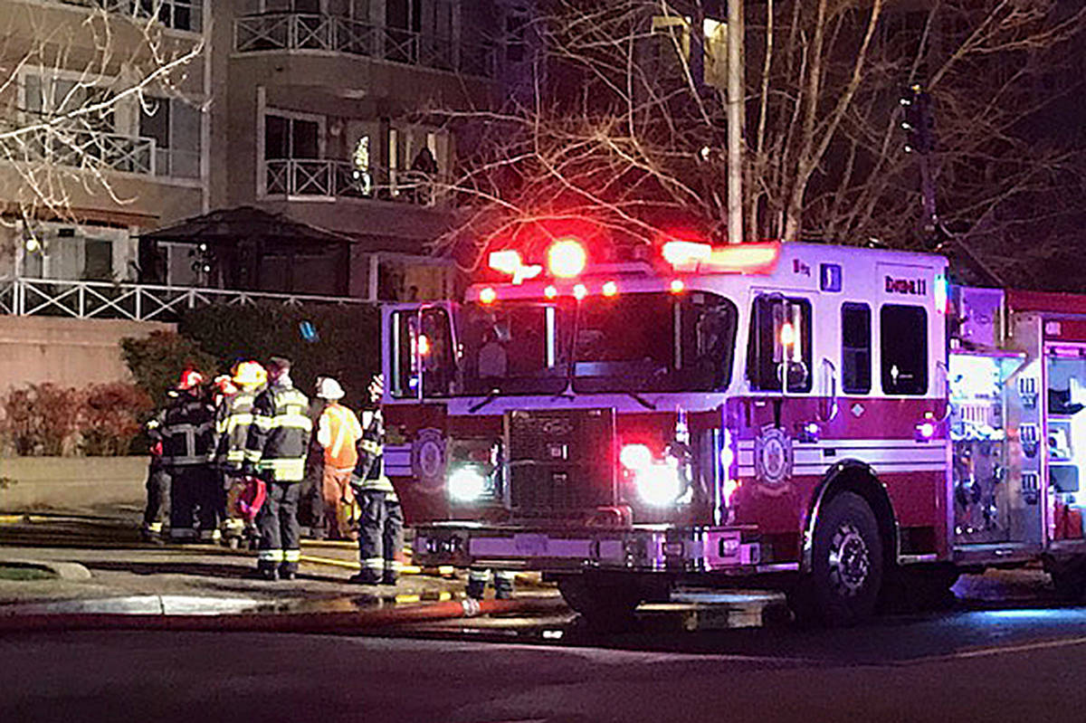 Fire crews are mopping up after a blaze on the outside of a Langley City apartment late Thursday afternoon. (Lisa Farquharson|Langley Advance Times)
