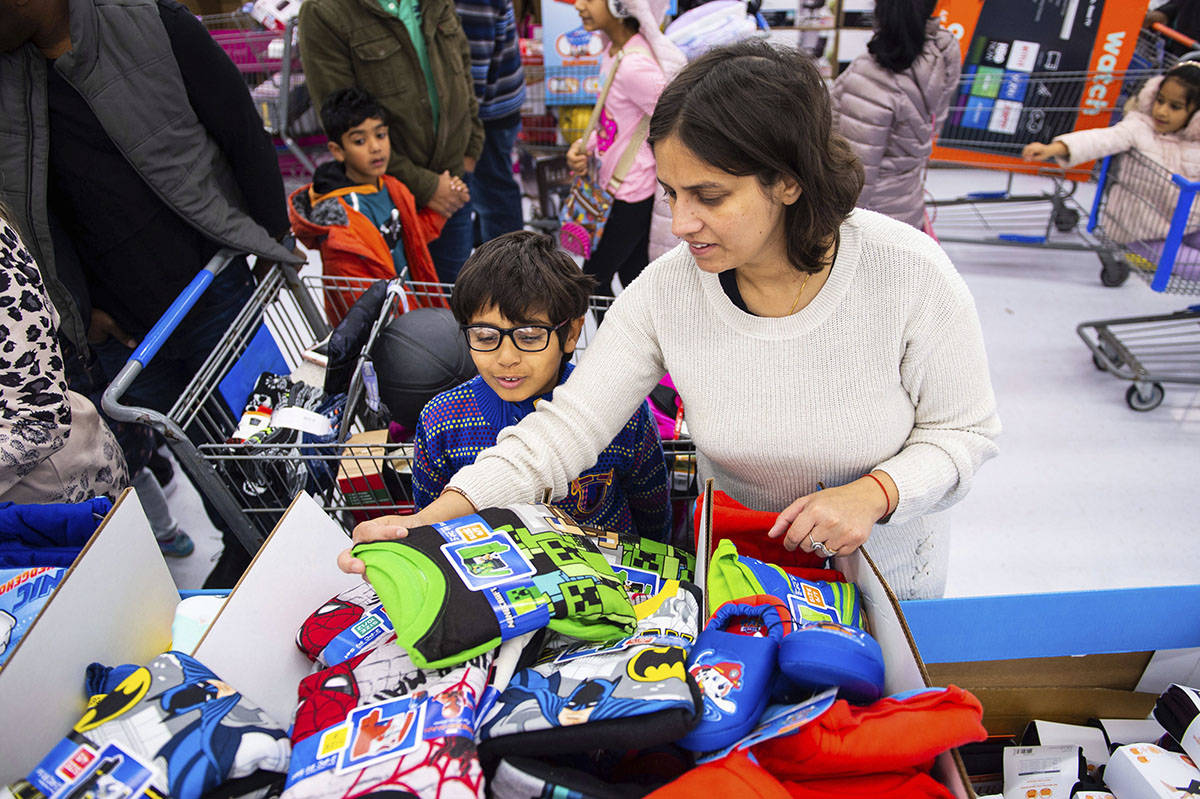 Customers shop for apparel at Walmart's Black Friday store event, on Thursday Nov. 28, in Bentonville, Ark. (Gunnar Rathbun/AP Images for Walmart)