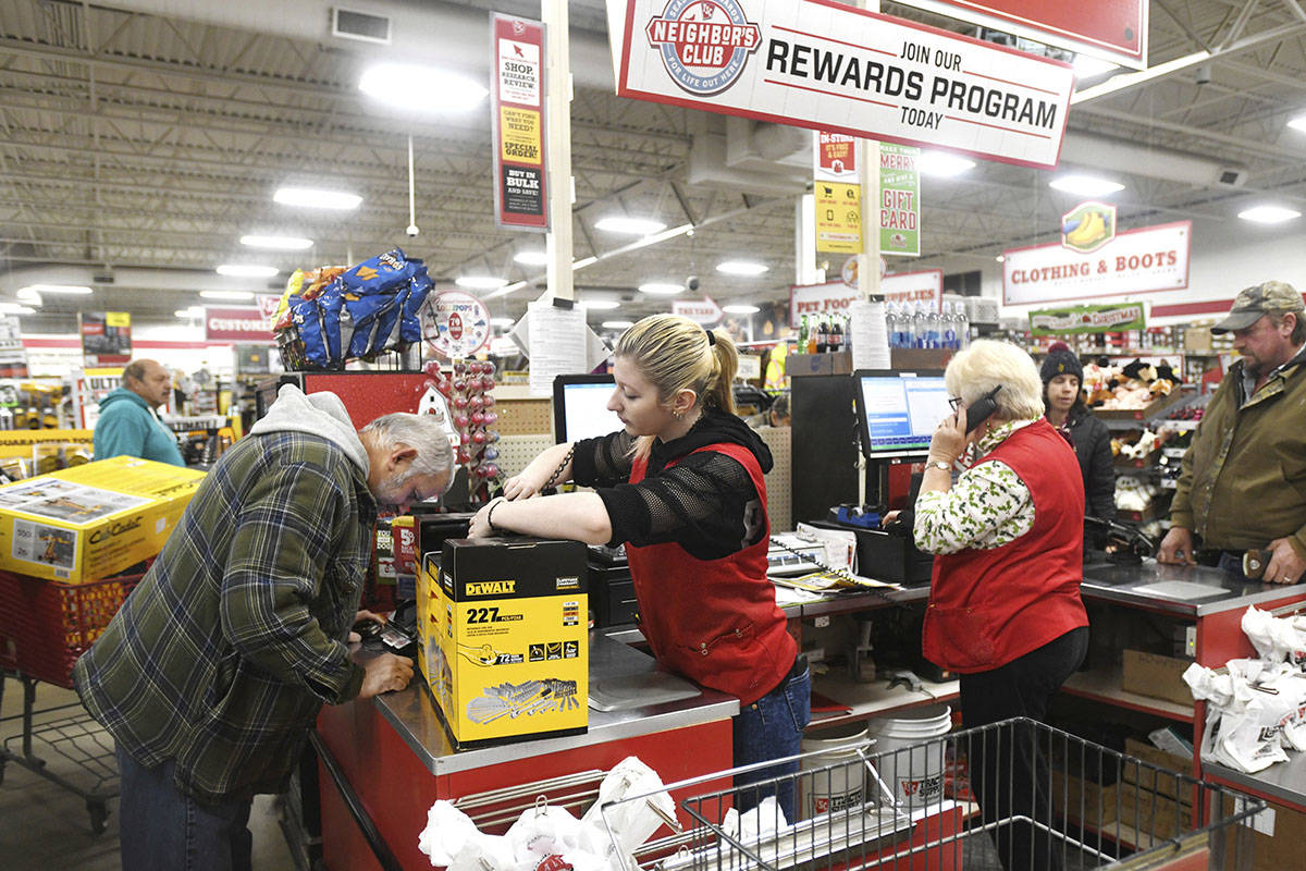Tractor Supply Company clerk Alex Ehasz, center, helps customer Scott Campbell at the Ashtabula Township, Ohio, store around 6 a.m. on Friday Nov. 29, 2019. The 2019 holiday season will be a good measure of the U.S. economy's health. (Warren Dillaway /The Star-Beacon via AP)