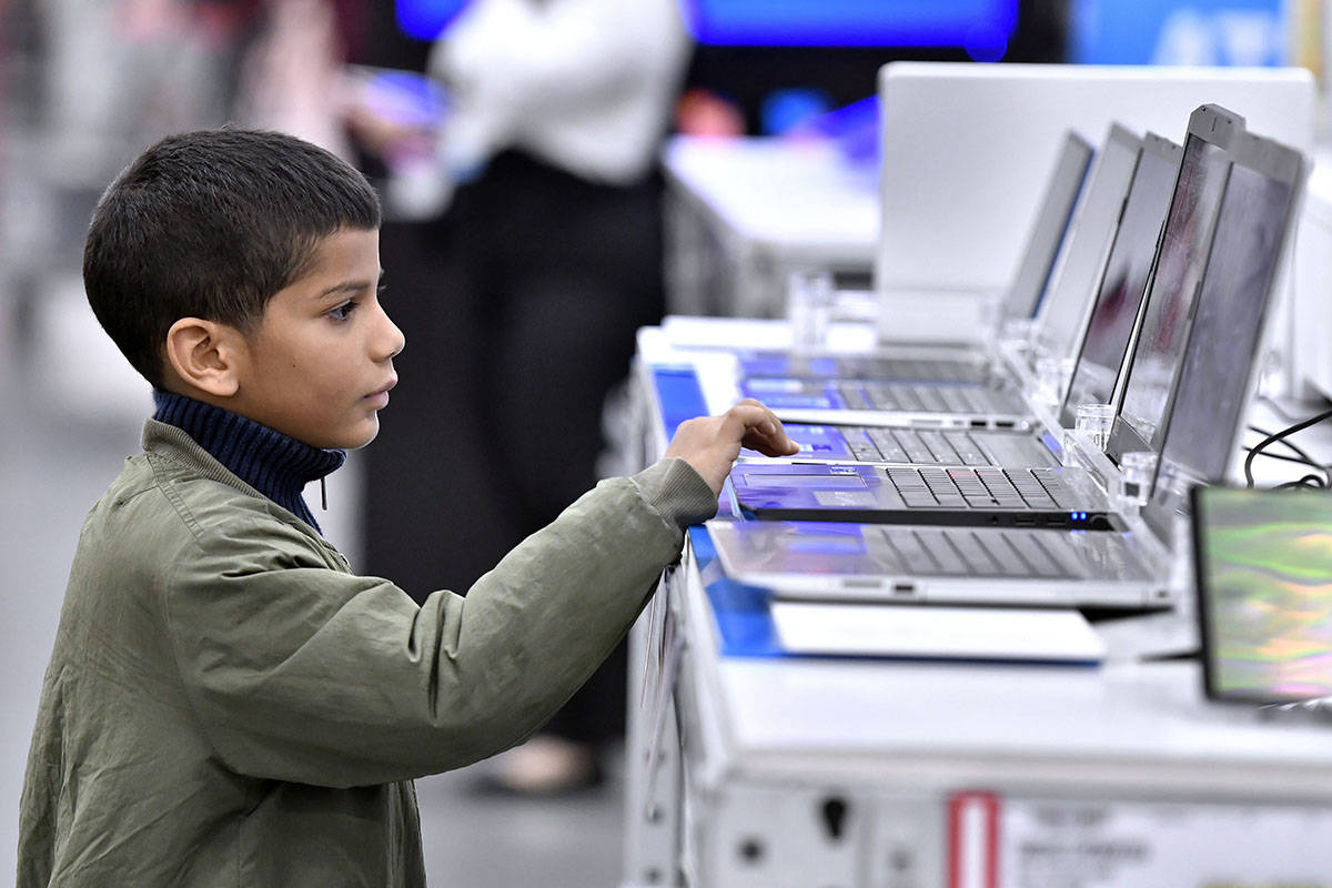 Manuel Gonzalez, 7, of Worcester, Mass., admires the laptop computers at BJ's Wholesale Club, while shopping with his father, Louis Gonzalez, during BJ's 11 Days of Black Friday Event on Friday, Nov. 29, 2019 in Northborough, Mass. (Josh Reynolds/AP Images for BJ's Wholesale Club)                                Manuel Gonzalez, 7, of Worcester, Mass., admires the laptop computers at BJ's Wholesale Club, while shopping with his father, Louis Gonzalez, during BJ's 11 Days of Black Friday Event on Friday, Nov. 29, 2019 in Northborough, Mass. (Josh Reynolds/AP Images for BJ's Wholesale Club)