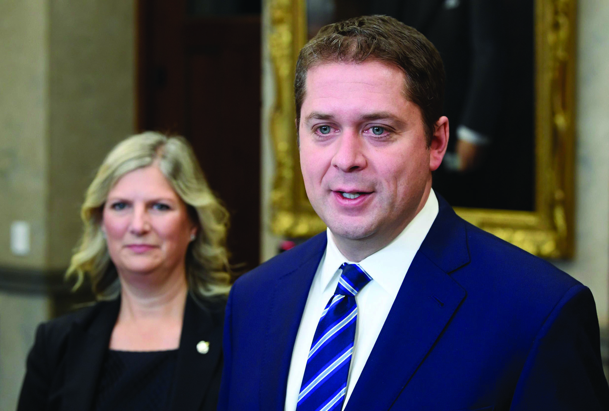 Conservative Deputy leader Leona Alleslev as Leader of the Opposition Andrew Scheer speak with the media in the Foyer of the House of Commons in West Block, Thursday November 28, 2019 in Ottawa. THE CANADIAN PRESS/Adrian Wyld