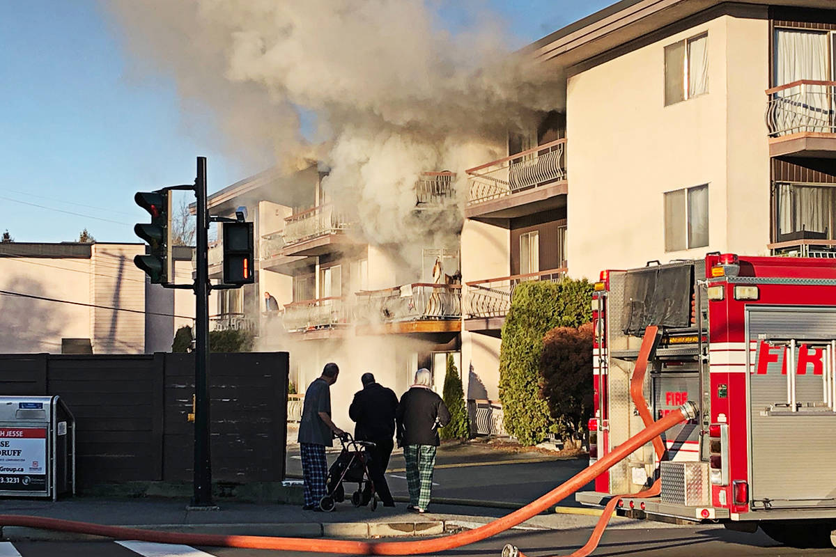 Firefighters were trying to douse a blaze in a low-rise apartment building in Langley City's downtown as of Friday morning. (Heather Colpitts/Langley Advance Times)                                Firefighters were trying to douse a blaze in a low-rise apartment building in Langley City's downtown as of Friday morning. (Heather Colpitts/Langley Advance Times)