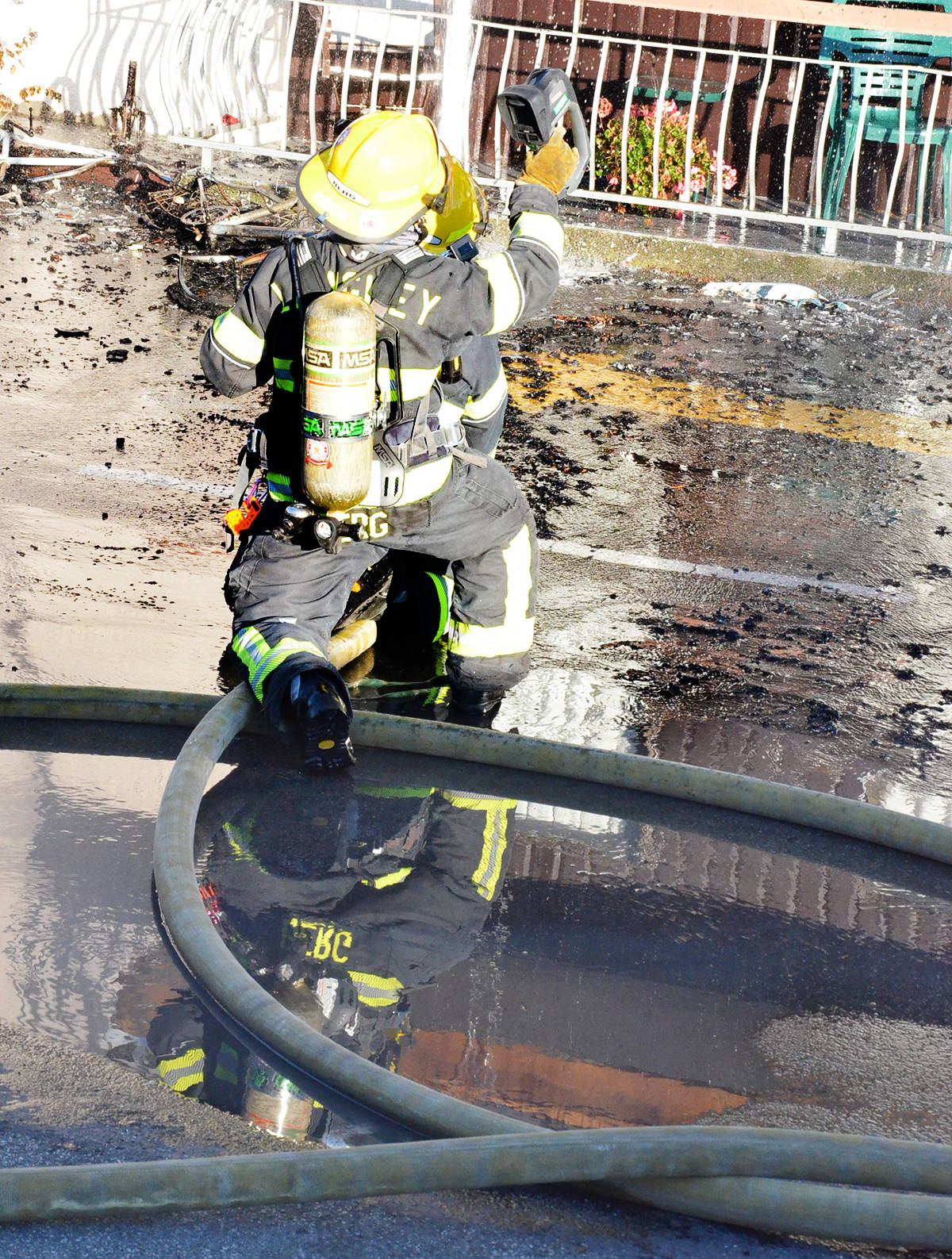 Firefighters used a thermal camera to detect hot spots. (Heather Colpitts/Langley Advance Times)