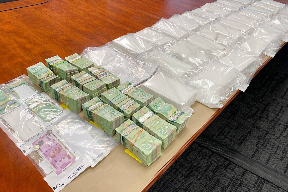 """On Nov. 29, Surrey RCMP displayed money and drugs seized in three recent busts that police say will have a """"significant impact on the flow of cocaine"""" at the street level. (Photo: Lauren Collins)"""