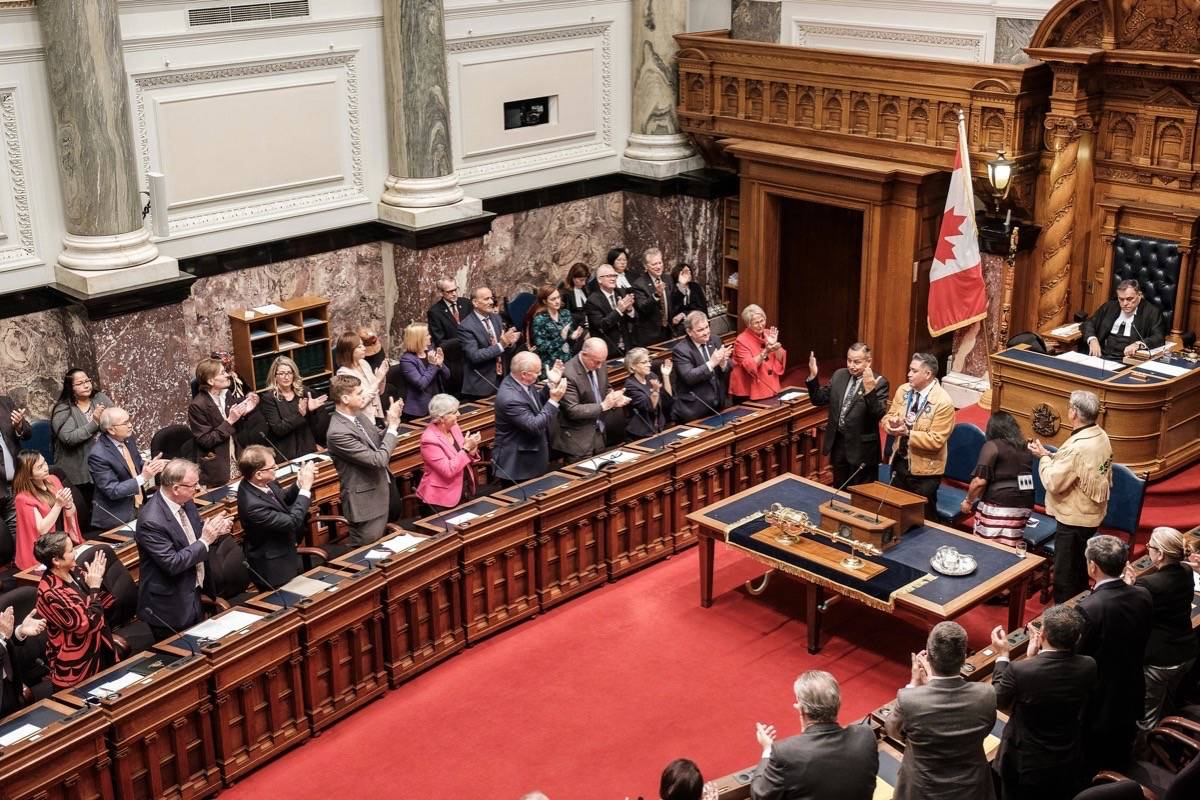 MLAs applaud Indigenous leaders as B.C.'s pioneering legislation to implement the United Nations Declaration on the Rights of Indigenous Peoples is introduced in the B.C. legislature, Oct. 24, 2019. (B.C. government)
