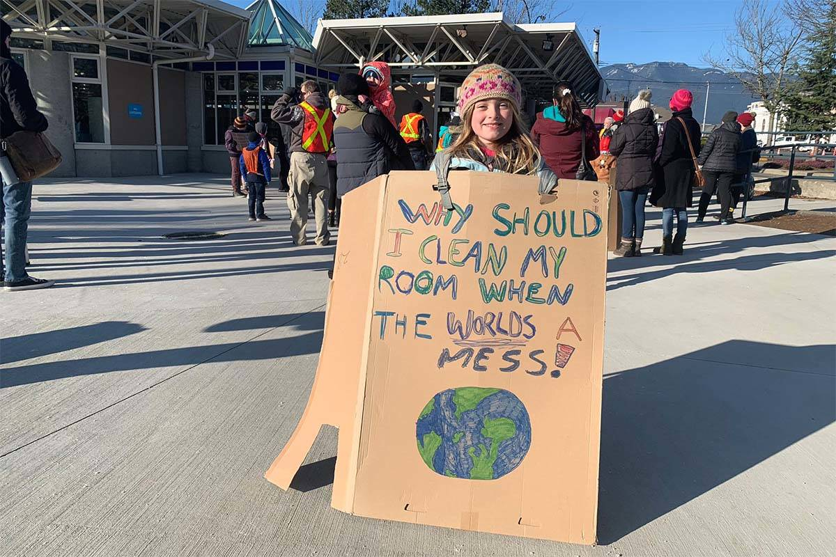 Eight-year-old Fintry LaPointe with a homemade sign at Salish Park in Chilliwack as people gathered to march to city hall as part of the Nov. 29, 2019 Global Climate Strike. (Paul Henderson/ The Progress)