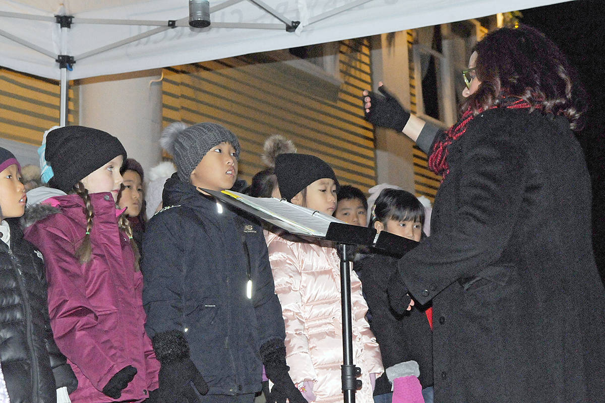 Those waiting for Santa's arrival at the hall enjoyed songs performed by the Langley Community Music School children's choir and complimentary hot drinks provided by Wendel's Bookstore and Cafe. (Dan Ferguson/Langley Advance Times)