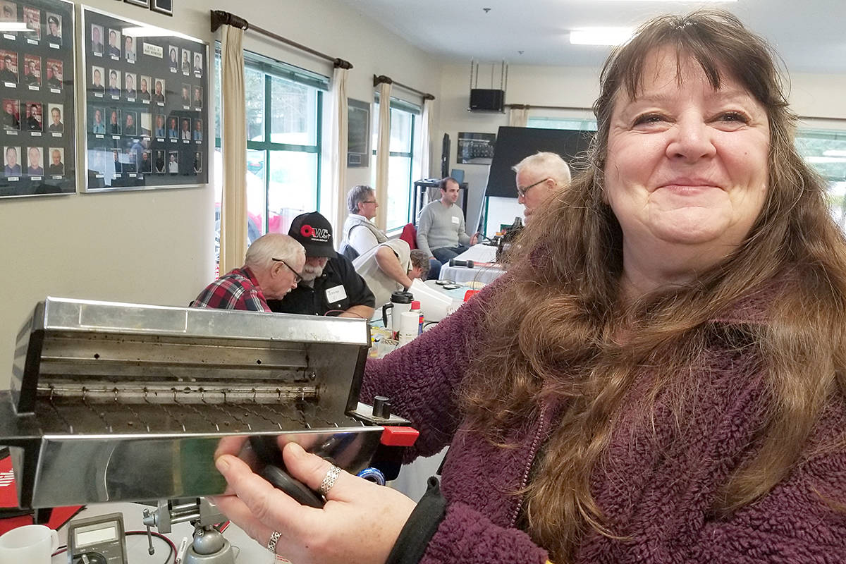 Rosemary Rose showed off her repaired 40-year-old toaster oven at the first repair cafe in Langley on Saturday, Nov. 30th. (Dan Ferguson/Langley Advance Times)