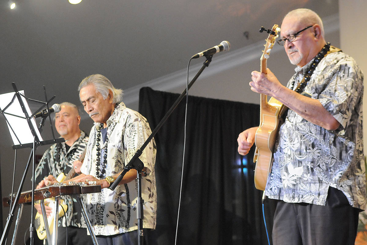 Live hawaiian-themed music was provided by the Outriggers, (L to R) Johnny Fatiaki, Kamoe Fatiaki, Homer Bentley at the Walnut Grove Lutheran Church on Saturday, Nov. 30. (Dan Ferguson/Langley Advance Times)