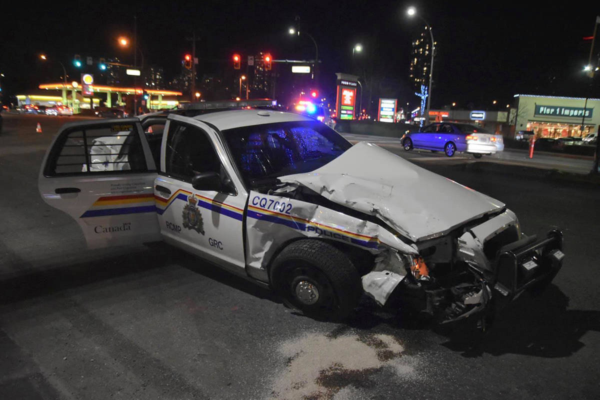 A Coquitlam RCMP car was hit in an intersection on Saturday, Nov. 30, 2019. (Mayor Richard Stewart/Facebook)