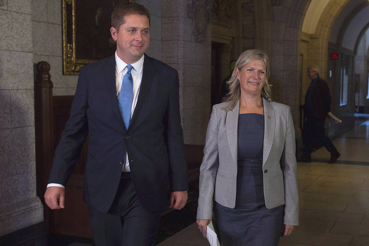 "Leader of the Opposition Andrew Scheer walks with Leona Alleslev, before Question Period on Parliament Hill in Ottawa, Monday, September 17, 2018. Andrew Scheer's second-in-command has apologized after comparing the Conservative leader's decision not to march in a Pride parade to choosing not to take part in a St. Patrick's Day parade. Leona Alleslev, who was named the Tories' deputy leader earlier this week, made the comments on an episode of the CBC News radio show ""The House"" that aired this morning. THE CANADIAN PRESS/Adrian Wyld"