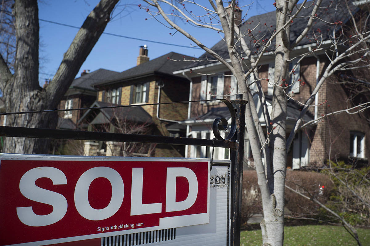 A sold sign is shown in front of west-end Toronto homes Sunday, April 9, 2017. Private listings and other alternative sales models are still outliers in Canada's real estate market, despite the Competition Bureau's success after seven years of litigation to force the Toronto board to share data on sale prices and listing history online. THE CANADIAN PRESS/Graeme Roy