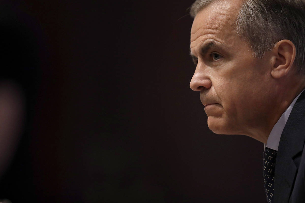 Mark Carney the Governor of the Bank of England listens to a journalist's question during a Financial Stability Report press conference at the Bank of England in the City of London, Thursday, July 11, 2019. THE CANADIAN PRESS/AP-POOL, Matt Dunham