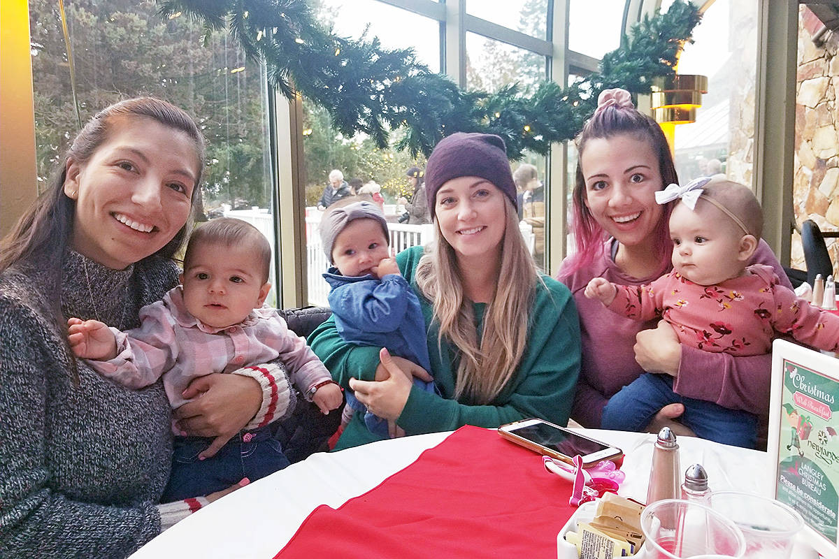 Some new moms and new babies had their first holiday outing at the Christmas Wish Breakfast at Newlands Golf & Country Club on Tuesday, Nov. 26. Karla Wilkinson and Olivia (left) from Aldergrove, Karline Johnson and Celia from Willoughby (centre) and and Hanna Strelau and Vaylin from Murrayville (right) all met in a prenatal class and all had girls the same month. (Dan Ferguson/Langley Advance Times)