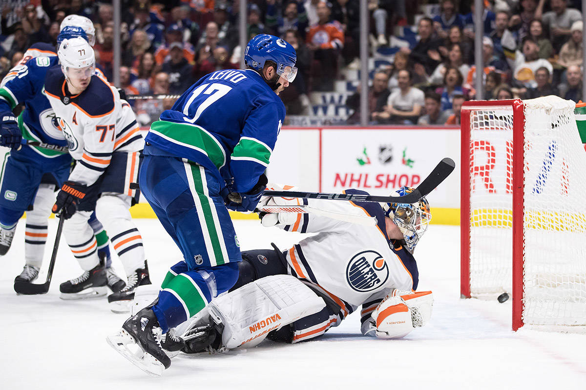 Vancouver Canucks' Josh Leivo (17) scores against Edmonton Oilers goalie Mikko Koskinen, of Finland, during the second period of an NHL hockey game in Vancouver, on Sunday December 1, 2019. THE CANADIAN PRESS/Darryl Dyck