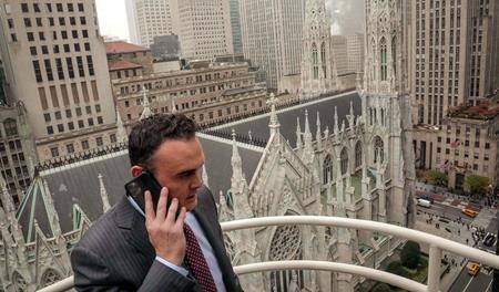 In this Tuesday, Oct. 29, 2019, photo, attorney Adam Slater takes a phone call on a patio outside his high-rise Manhattan office overlooking St. Patrick's Cathedral, in New York. (AP Photo/Bebeto Matthews)