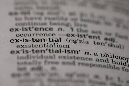 "This Sunday, Dec. 1, 2019, photo shows the word ""existential"" in a dictionary in the Brooklyn borough of New York. (AP Photo/Jenny Kane)"