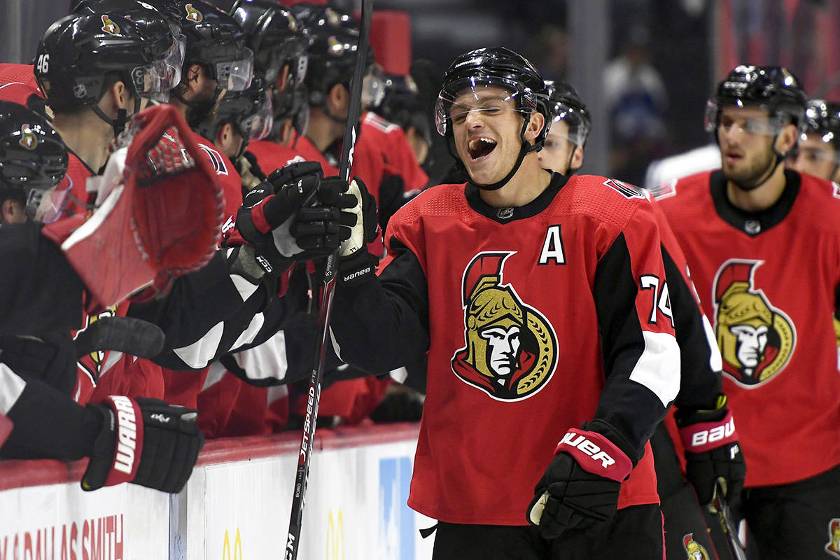 Ottawa Senators defenceman Mark Borowiecki (74) high fives teammates to celebrate a goal scored by Connor Brown against the Toronto Maple Leafs during first period of preseason NHL hockey action in Ottawa, Wednesday September 18, 2019. Borowiecki fights crime on his days off from the rink. Vancouver Police have confirmed that the 30-year-old Borowiecki halted an attempted robbery on Sunday in the city while he was out for a walk. THE CANADIAN PRESS/Justin Tang